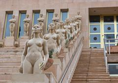 stairs with statute of naked ladies - stock photo
