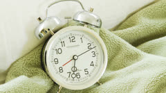Time lapse of a White alarm clock on blanket Stock Footage