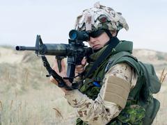 Soldier in desert uniform Stock Photos