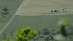 Hay harvest with a tractor in the German highland Stock Footage