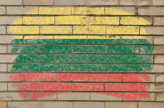 flag of lithuania on grunge brick wall painted with chalk - stock photo