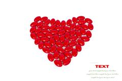 red medicinal pills heart shape on a white background with space for text - stock illustration