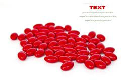 red medicinal pills on a white background with space for text - stock illustration