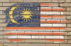 flag of malaysia on grunge brick wall painted with chalk - stock photo