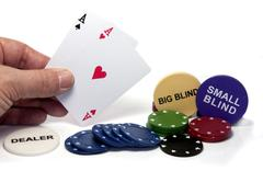 hand with two aces during poker game - stock photo