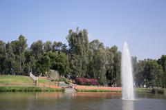 Park setting with it's waterfalls and fountain Stock Photos