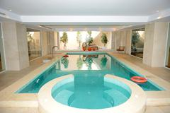 swimming pool with jacuzzi in spa at the luxury hotel, peloponnes, greece - stock photo