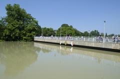 bridge over flooding river - stock photo