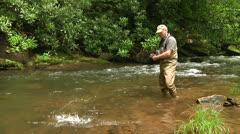 Fisherman Landing Trout Stock Footage