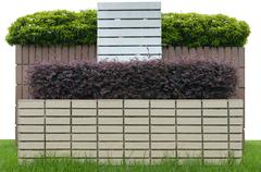 decorative garden on a brick fence isolated on white background - stock photo