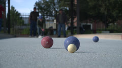 BOCCE BALL GAME BEING PLAYED ON OUTDOOR COURT HD 1080 Stock Footage