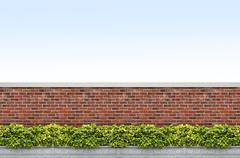 shrubs and brick fence - stock photo