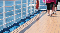 Couple walking on cruise ship deck for exercise HD 7832 Stock Footage