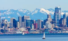 Seattle skyline sailboats puget sound cascade mountains washington state Stock Photos