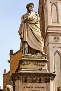 dante statue basilicasanta croce facade florence italy - stock photo