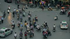 Motorcyclists at Crossroads in Vietnam Stock Footage