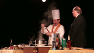 Stock Video Footage of Cruise ship Head Chef Maitre D cooking demonstration comedy HD 7762