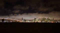 Time Lapse View of the Foggy San Francisco Skyline at Night - stock footage