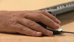 hand uses computer mouse - stock footage