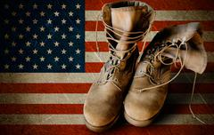army boots on sandy flag background - stock photo