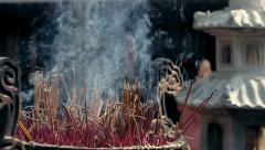 Candle smoke in a temple Vietnam 3 - stock footage