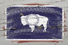 flag of us state of wyoming on grunge wooden texture precise painted with cha - stock photo