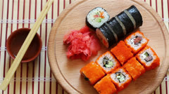 Sushi set rotate on wooden plate Stock Footage