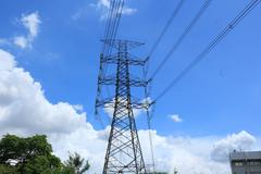 high voltage post with blue sky. - stock photo