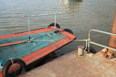 Mooring at a pier, a boat moored with a line tied around a metal fixing on th Stock Photos