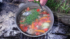 Fish soup on fire outside Stock Footage