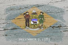 flag of us state of delaware on grunge wooden texture precise painted with ch - stock photo