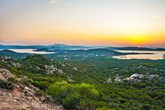 la maddelena, sardinia, sunset at the shore - stock photo