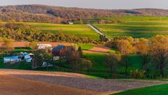 Houses, roads, farm fields and rolling hills of southern york county, pennsyl Stock Photos