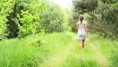 Woman walking in the forest Stock Footage