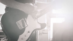 Guitar Playing and lens flare. Black and white Stock Footage