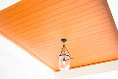Modern ceiling lamp in a new home Stock Photos