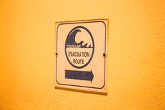 tsunami evacuation route sign on up stair way - stock photo