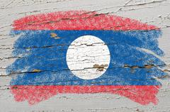 flag of laos on grunge wooden texture painted with chalk - stock photo