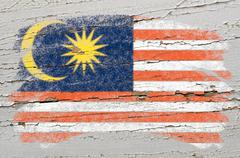 flag of malaysia on grunge wooden texture painted with chalk - stock photo