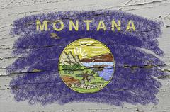 flag of us state of montana on grunge wooden texture precise painted with cha - stock photo