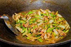 Cooking fried parkia with shrimp thai food Stock Photos
