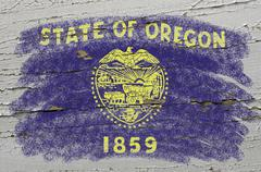 flag of us state of oregon on grunge wooden texture precise painted with chal - stock photo
