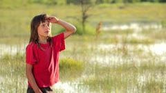 Boy on a flooded meadow, swamp boy explores Stock Footage