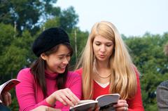 multicultural girls studying in college - stock photo