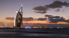 Ultra HD 4K Dubai Skyline Illuminated Burj Al Arab UAE Dusk Night time lapse Stock Footage