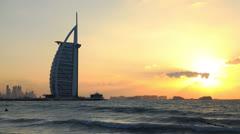 Ultra HD 4K Dubai Skyline Luxurious Burj Al Arab UAE Cityscape Sunset time lapse Stock Footage