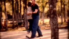 1950s film couple dancing female male park hot sunny day people lifstyle Stock Footage
