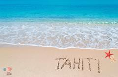 "turquoise foreshore with ""tahiti"" written on it - stock photo"