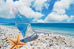bottle and sea star - stock photo