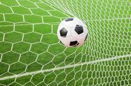 Stock Photo of soccer ball in the goal net